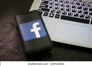 CHIANGMAI, THAILAND -NOV 18,2018:Smart phone open Facebook application. Facebook is most popular social network application that connects people together online. Keyword:
