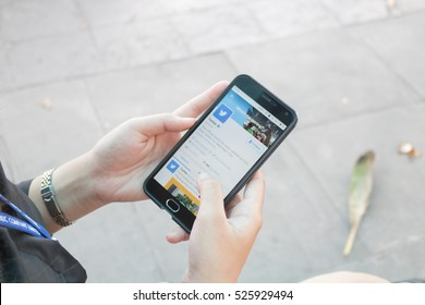 CHIANGMAI, THAILAND -NOV 29,2016:Women hand holding smartphone and using Twitter application,Twitter is an online social networking.