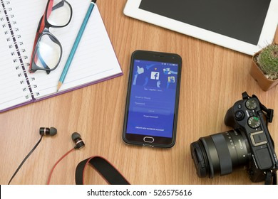 CHIANGMAI, THAILAND -NOV 30,2016:Smart phone open Facebook application. Facebook is most popular social network application that connects people together online.