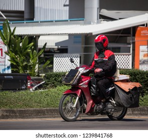 Chiangmai, Thailand - November 15 2018: Postman and Motercycle of Thailand Post. Photo at road no.121 about 8 km from downtown Chiangmai, thailand.
