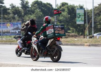 Chiangmai, Thailand - November 23 2018: Delivery service man ride a Motercycle of The Pizza Company. On road no.1001, 8 km from Chiangmai city.