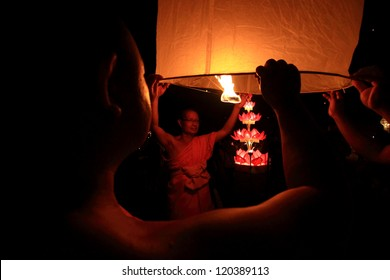 CHIANGMAI, THAILAND - NOVEMBER 24:Thai people floating lamp. November 24 ,2012 in Tudongkasatarn, Chiangmai, Thailand. Tudongkasatarn is where floating lamp ceremony takes place every year