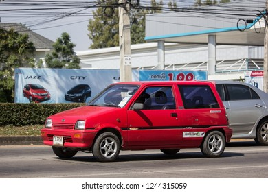 Chiangmai, Thailand - November 26 2018: Private Small city car, Daihatsu Mira. Photo at road no 121 about 8 km from downtown Chiangmai, thailand.