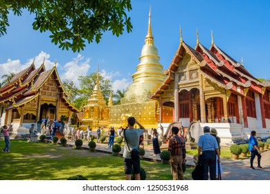 CHIANGMAI, THAILAND - NOVEMBER 30, 2018 : Many tourists is taking picture of Wat Phra Singh temple in Chiangmai, Thailand.