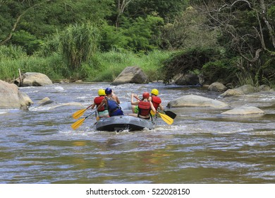 Chiangmai, Thailand - November 9, 2016: Tourists paddle whitewater river in Mae Taeng district of Chiang Mai. Chiang Mai, Thailand.