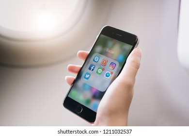 CHIANGMAI, THAILAND - OCT 24 ,2018 : Hand of woman using Iphone 6S with icons of social media on screen, smartphone life style, smartphone era, smartphone in everyday life