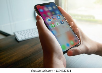 CHIANGMAI, THAILAND - OCT 4,2018 : Hand of woman using IphoneX with icons of social media on screen, smartphone life style, smartphone era, smartphone in everyday life