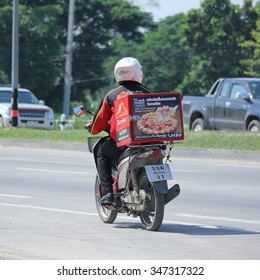 CHIANGMAI, THAILAND -OCTOBER  18 2015:  Delivery service man ride a Motercycle of Pizza Hut Company. Photo at road no.1001 about 8 km from downtown Chiangmai, thailand.