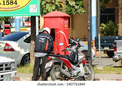 Chiangmai, Thailand - October 23 2012: Postman and Motercycle of Thailand Post. Photo at Chiangmai Bus Staion, thailand.