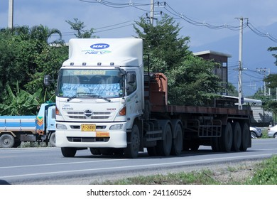 CHIANGMAI, THAILAND -OCTOBER 25 2014: Trailer Truck of MMT Logistic transport company. Photo at road no.121 about 8 km from downtown Chiangmai, thailand.