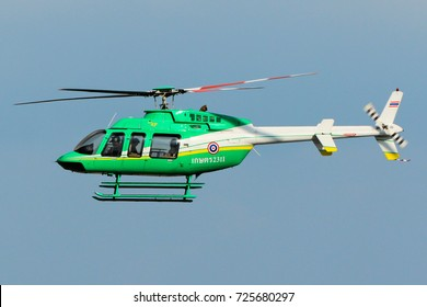 Chiangmai, Thailand. October 3, 2015. Bureau of Royal Rainmaking and Agricultural Aviation (KASET) Bell 407 Reg. 2311 flying Over Chiangmai International Airport with Blue Sky.