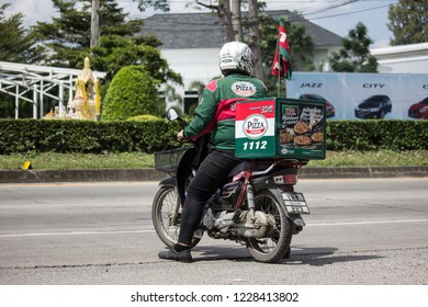 Chiangmai, Thailand - October 30 2018: Delivery service man ride a Motercycle of The Pizza Company. On road no.1001, 8 km from Chiangmai city.