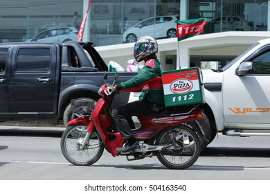 CHIANGMAI, THAILAND - OCTOBER 8  2016:  Delivery service man ride a Motercycle of The Pizza Company. In Busy Traffic On road no.1001, 8 km from Chiangmai Business Area.