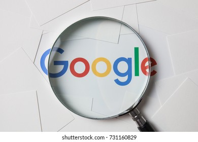 CHIANGMAI, THAILAND - October 8, 2017:Photo of logo of Google on printing paper on the working table with magnifying glass.