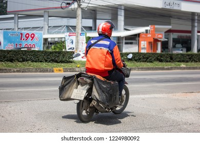 Chiangmai, Thailand - October 8 2018: Postman and Motercycle of Thailand Post. Photo at road no.121 about 8 km from downtown Chiangmai, thailand.