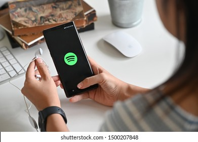 CHIANGMAI, THAILAND SEP 10 2019 : Woman holding Samsung Note 9 with Spotify logo on the screen. Spotify is a popular music streaming service.