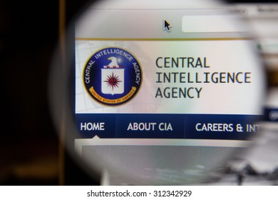 CHIANGMAI, THAILAND - September 1, 2015:Photo of cia central intelligence agency. page on a monitor screen through a magnifying glass.