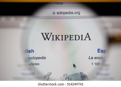 CHIANGMAI, THAILAND - September 1, 2015:Photo of Wikipedia homepage on a monitor screen through a magnifying glass.
