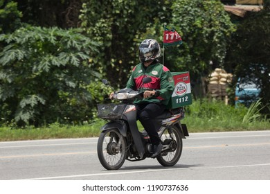Chiangmai, Thailand - September 1 2018: Delivery service man ride a Motercycle of The Pizza Company. On road no.1001, 8 km from Chiangmai city.
