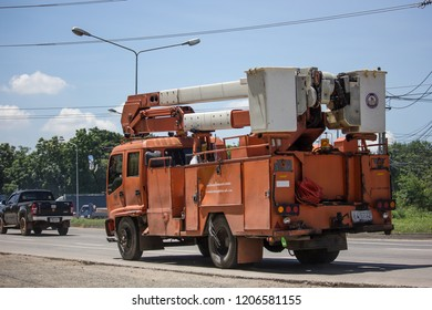Chiangmai, Thailand - September 21 2018: Bucket Truck of Provincial eletricity Authority of Thailand. Photo at road no.1001 about 8 km from downtown Chiangmai, Thailand.