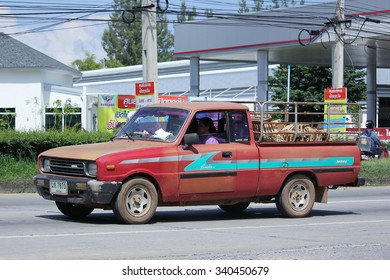 CHIANGMAI, THAILAND -SEPTEMBER  28 2015:  Private Pick up Truck, Mazda Family mini Pick up truck. Photo at road no 121 about 8 km from downtown Chiangmai, thailand.