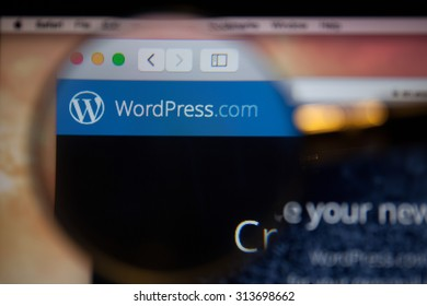 CHIANGMAI, THAILAND - SEPTEMBER 6, 2015:Photo of WordPress.com homepage on a monitor screen through a magnifying glass.