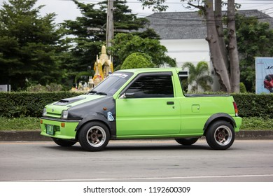 Chiangmai, Thailand - September 6 2018: Private Small city car, Daihatsu Mira. Photo at road no 121 about 8 km from downtown Chiangmai, thailand.