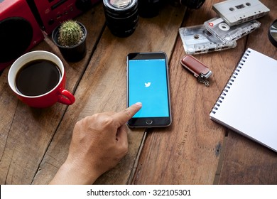 """CHIANGMAI, THAILAND -SPE 30, 2015:Twitter is an online social networking and microblogging service that enables users to send and read """"tweets"""""""