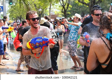 CHIANGMAI THAILAND-APRIL 13:Chiang Mai Songkran festival. Thai people and tourist play water fighting around Tapae gate walking street. on April 13,2012 in Chiang Mai,Thailand.