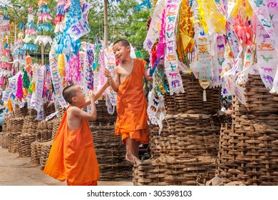 CHIANGMAI, THAILAND-APRIL 14, 2010 : Songkran Festival is celebrated in a traditional New Year's Day. Little monks come to decorate tung in the temple Wat LokMoLee. Chiang Mai,Thailand.