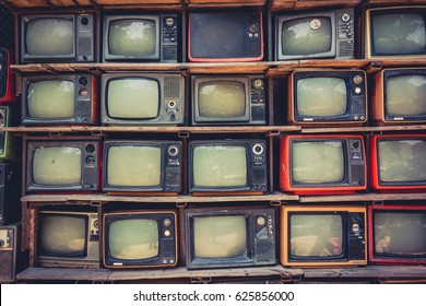 Chiangmai, Thailand-April 22, 2017: Pattern wall of pile old retro TV ,With vintage filter effect style.