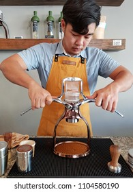 Chiangmai, Thailand-Circa February 2018: At Roxpresso coffee craft, a barista is at his stage to make an espresso cup by hands with ROK espresso maker that is a manual non-electric coffee machine.
