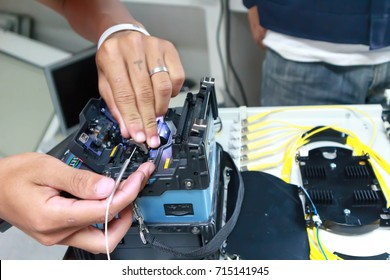 Chiangmai,THAILAND 28 August 2017 ; Technicians are cutting and fusing fiber optic cables.