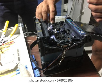 Chiangmai-Thailand. August 11,2017. The company brought the technician into the fiber optic cable in the server room at Ricd