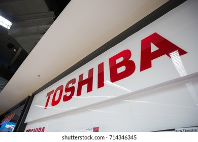"Chiangmai,Thailand June 16, 2017: The logo of the brand ""Toshiba"". Toshiba is a famous Japanese multinational corporation whose products and services include IT and communications equipment."
