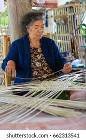 CHIANGMAI,THAILAND - MARCH  30, 2011 : Thai lady makes wicker work baskets using material from the bamboo tree in Chiangmai Thailand.