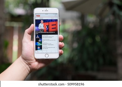CHIANGMAI,THAILAND - NOV 02,2016 : A hand holding Apple iPhone 6 plus with shows details of TED app main page.