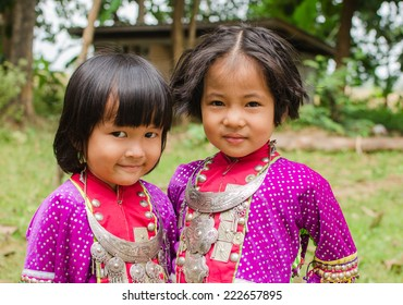 CHIANGMAI,THAILAND - OCTOBER 8, 2014: Unidentified Palaung kid in the Palaung traditional costume poses for the camera. Palaung people is a minority ethnic group living in northern Thailand
