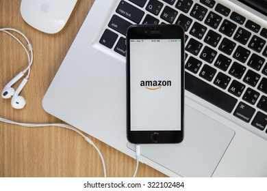 CHIANGMAI,THAILAND - SEPTEMBER 30, 2015:Amazon application on Apple iPhone 5s and Macbook display. Amazon is an American international electronic commerce company