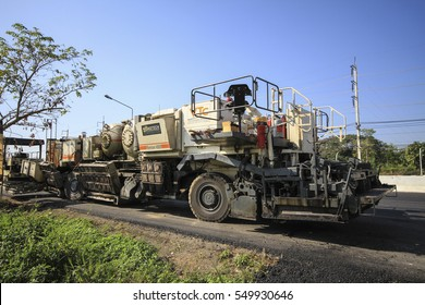 CHIANGMAI,THAILAND,DEC 28 2016 : Asphalting the roadworks. Hot mix asphalt concrete is produced by heating the asphalt binder to decrease its viscosity,at chiang mai,thailand.