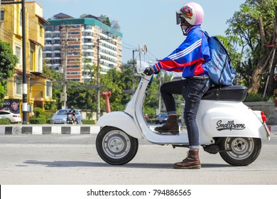 CHIANGMAI,THAILAND,DECEMBER 11, 2017 : Private Scooter Motorcycle Vespa. On Nimmanhaemin Road. One of Chiang Mai's neighbourhoods known for its restaurants, shops, galleries, and cafes.