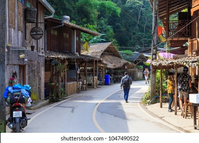 CHIANGMAI,THAILAND-JANUARY 17,2018 : Tourist walking around Mae kampong, A small village on the mountain in northern Thailand. The house is made of wood and has a small street