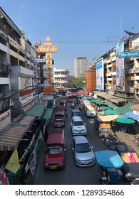 Chiangmai,Thailand:January 20,2019: Traffic around Warorot market or Kad Luang  Red cars park along the street
