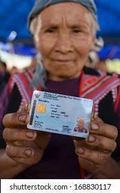 CHIANGRAI - AUGUST 2, 2013 : Unidentified hill tribe show her national id card in Chiang Rai, Thailand.