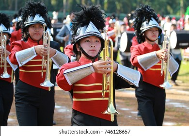 Chiang-rai Oct 31: Young musicians in red shirt playing trumpet in marching band in October 31, 2017 in Chiang-rai, Thailand.
