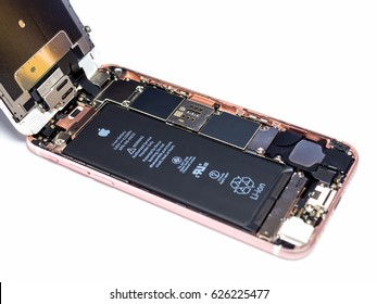 Chiangrai, Thailand: April 8, 2017 - Apple iPhone 6S rose-gold color disassembled for repair and showing components inside on white background . Selective focus