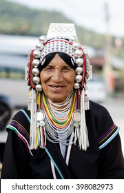 Chiangrai, Thailand - February 12,2016 : An unidentified lady with traditional headdress in Ahka hill tribe in Chiangrai, Thailand on February 12 , 2016