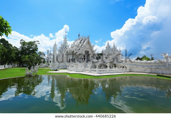 CHIANGRAI, THAILAND - May 2016: Unidentified travelers visit Wat Rong Khun a famous white temple at northen thailand on May 28, 2016 at Wat Rong Khun, Chaingrai, Thailand.