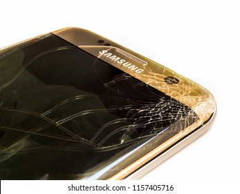 Chiangrai, Thailand: September 09, 2017 - Close-up image of cracked screen Samsung S7 edge smartphone cause of accident prepairing to repair on white background