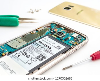 Chiangrai, Thailand: September 20, 2017 - Close-up image of inside disassembled broken Samsung Galaxy S7 edge smartphone preparing to repair with tools